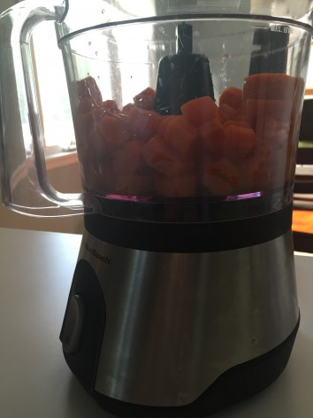 Cooked carrots in a food processor - image
