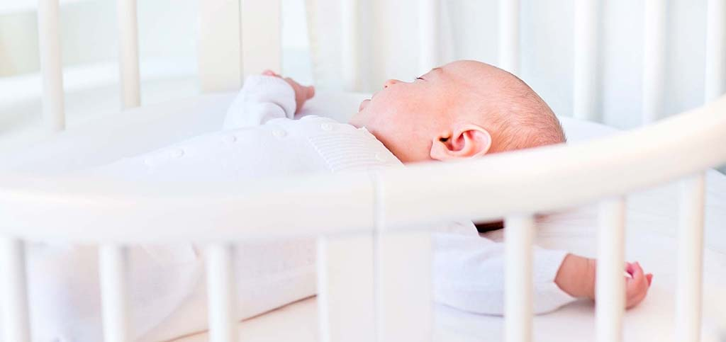 baby in crib–banner